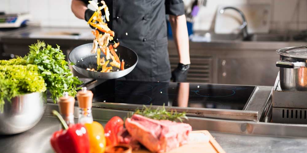 Professional Culinary Torch - A Chef is Stir-frying Bell Peppers with O-Grill Professional Culinary Torches